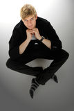 Handsome young caucasian man, cross-legged stock photo