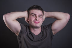 Handsome young caucasian man flexing and stretching stock photos