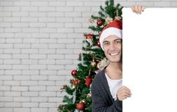 Handsome and young caucasian man holding and pointing to blank w royalty free stock photography