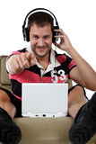 Handsome young caucasian man, music listening Royalty Free Stock Photos