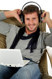Handsome young caucasian man, music listening Stock Image
