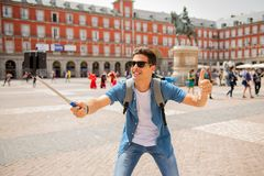 Handsome young caucasian tourist man happy and excited taking a selfie in Plaza Mayor, Madrid Spain. Attractive young caucasian tourist student man having fun Royalty Free Stock Photos