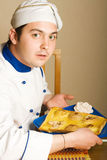 Handsome Young Chef In The Living Room With Pirogo Stock Photography
