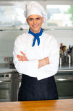 Handsome young chef posing in uniform Royalty Free Stock Photography