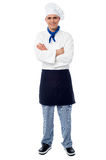 Handsome young chef posing in uniform Stock Image
