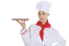 Handsome young chef in uniform. Royalty Free Stock Images