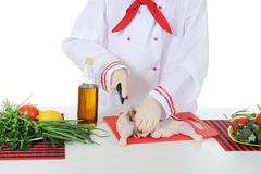 Handsome young chef in uniform. Royalty Free Stock Image