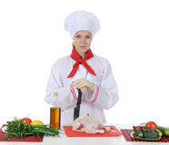 Handsome young chef in uniform. Stock Image