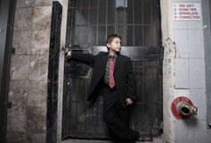 Handsome young child in a business suit Stock Photos