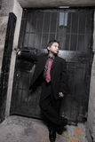 Handsome young child in a business suit. Handsome boy in a business suit in an urban setting Royalty Free Stock Photo