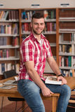 Handsome Young College Student In A Library Royalty Free Stock Photography