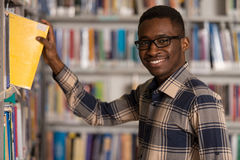Handsome Young College Student In A Library Royalty Free Stock Photos