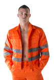 Handsome young construction worker with orange suit Royalty Free Stock Photography