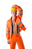 Handsome young construction worker with orange suit open on naked torso Stock Image