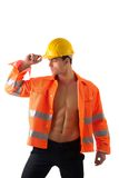 Handsome young construction worker with orange Stock Photography