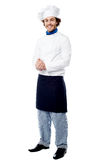 Handsome young cook posing in uniform Stock Photography
