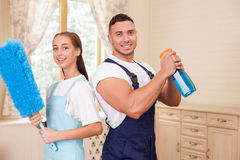 Handsome young couple is doing clean-up in house Stock Photo