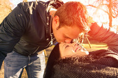 Handsome young couple having fun together outdoor. Lovers on a romantic date - Concepts of love and relationship - Warm filtered look with artificial sunlight Stock Photography