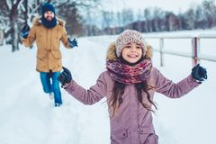 Dad with daughter outdoor in winter. Handsome young dad and his little cute daughter are having fun outdoor in winter. Enjoying spending time together. Family Royalty Free Stock Photos