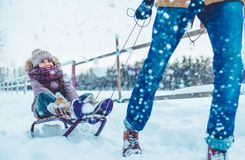 Dad with daughter outdoor in winter. Handsome young dad and his little cute daughter are having fun outdoor in winter. Enjoying spending time together while Royalty Free Stock Photo