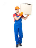 Handsome young delivery man with paper boxes Stock Photos