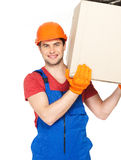 Handsome young delivery man with paper boxes Royalty Free Stock Photo