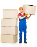 Handsome young delivery man with paper boxes Royalty Free Stock Photography