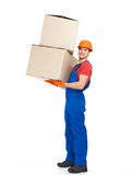 Handsome young delivery man with paper boxes Royalty Free Stock Images