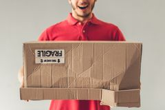Handsome young delivery worker Stock Image