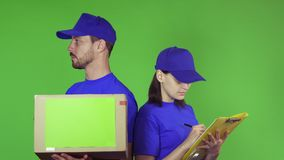 Cheerful delivery workers with a package smiling to the camera stock footage