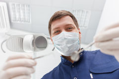 Handsome young dentist is working with his Stock Image