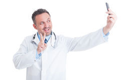 Handsome and young doctor or medic taking a selfie Stock Photography
