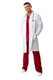 Handsome young doctor in medical gown,  Royalty Free Stock Images