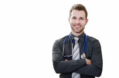 Handsome young doctor on a white background Stock Photos