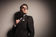 Handsome young elegant business man looking up. Royalty Free Stock Photography