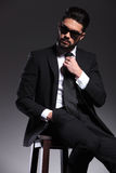 Handsome young elegant business man sitting on a stool Royalty Free Stock Images