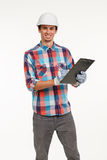 Handsome young engineer with clipboard. Royalty Free Stock Photos