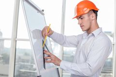 Handsome young engineer is working on a new Stock Image
