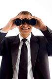 Handsome young executive with binoculars Stock Image