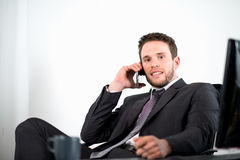 Handsome young executive business man in office Royalty Free Stock Images