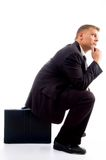 Handsome young executive in deep thought sitting Stock Images