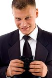 Handsome young executive holding Royalty Free Stock Photo