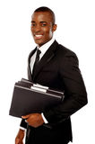 Handsome young executive holding files Stock Photo