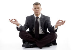 Handsome young executive practicing yoga Royalty Free Stock Images