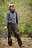 Handsome young farmer. Outdoor near a forest Royalty Free Stock Photography
