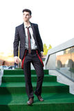 Handsome young fashion male model. Wearing shirt and red braces posing outdoors Stock Photography