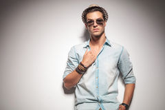 Handsome young fashion man pulling his shirt. Stock Images
