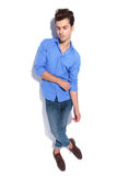 Handsome young fashion man pulling his sleeve Royalty Free Stock Photos