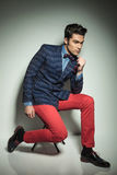 Handsome young fashion man sitting on a chair Stock Images