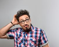 Handsome young Fashion man Thinks Idea. Crazy Nerd. Handsome young man Thinks Idea, Crazy. Portrait Hipster Nerd Loser guy in Trendy shirt, Glasses. Brunette stock photo